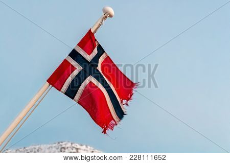 Flag Of The Kingdom Of Norway Flutters In The Wind On Mast Of A Ship.
