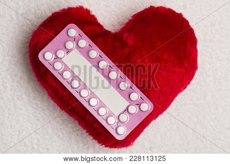Medicine Contraception Love And Birth Control. Oral Contraceptive Pills On Red Heart Shaped Little P