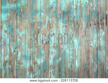 Flaking Blue Painted Old Grey Wooden Plank Wall Or Fence
