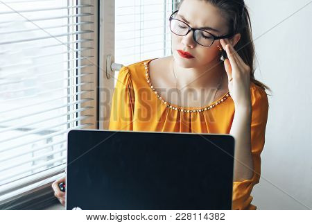 Head Pain Of Freelance Woman, Young Woman Holding Hands On Head Near Computer, Stress Or Depression