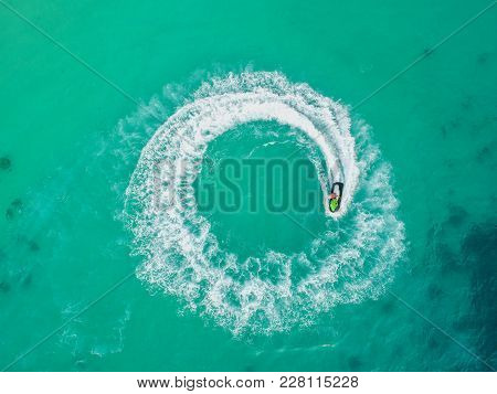 People Are Playing A Jet Ski In The Sea.aerial View. Top View.amazing Nature Background.the Color Of