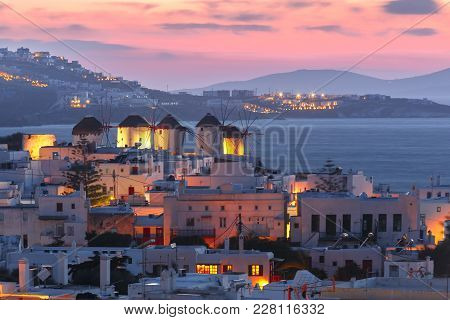 Famous View, Traditional Windmills On The Island Mykonos, The Island Of The Winds, At Sunset, Greece