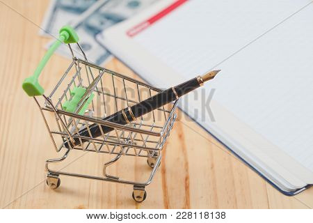 Online Business Concept Fountain Pen In Shopping Cart.