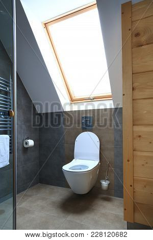 Clean Modern Toilet With Window. Interior Of New Bathroom.