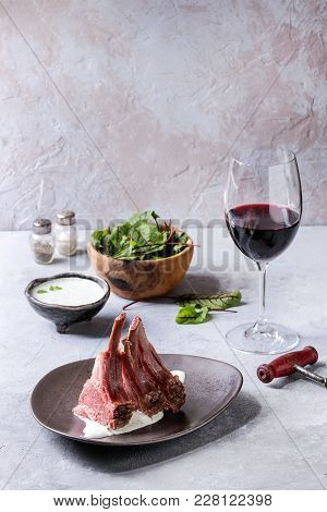 Grilled Sliced Rack Of Lamb With Yogurt Mint Sauce Served In Ceramic Plate With Green Salad Young Be