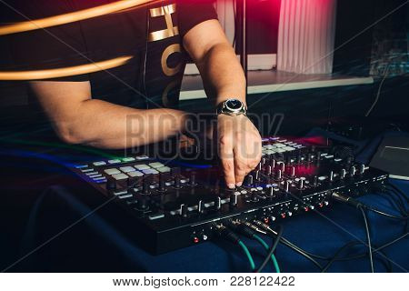 Dj Plays Hands On Professional Turntables At A Party At A Nightclub