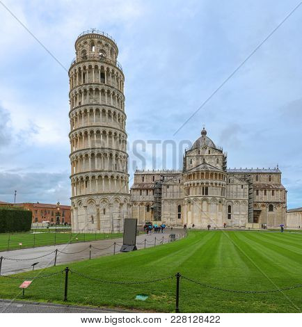 Famous Leaning Tower Of Pisa Next To Cathedral In Italy