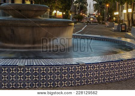 Pair Of Fountains Connected By Small Canal Along Figueroa Street In City Of Ventura In Early Hours O
