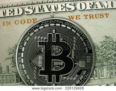 In Code We Trust. Blockchain Crypto Technology Principle. Bitcoin Metal Coin Is On Hundred Dollar Ba