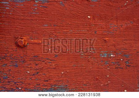 Background - Old Wooden Surface Painted Boards. Close-up. The Old Red Paint All Cracked From Time To
