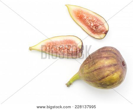 One Fig And Two Slices Top View Isolated On White Background Ripe Purple Green Rose Flesh