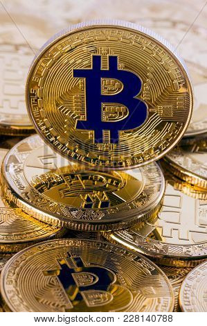 Pile Of Bitcoins With Single Coin Standing On Top Of The Other, Financial Background Or Cryptocurren