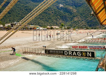 Oludeniz, Turkey - May 11, 2017: Sailing Ships For Sea Excursions In The Harbor, Movable Bridges For
