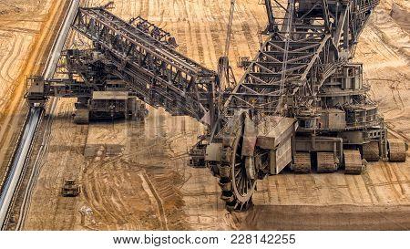 Huge Bucket Wheel Excavator Mining For Brown Coal In An Open Pit Mine.