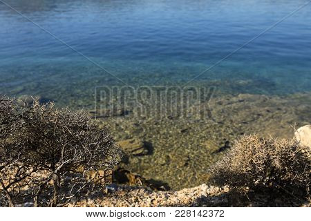 Summer Time View From The Beach To The Crystal Clear Sea Water Love Bay Poros Island Greece. Horizon