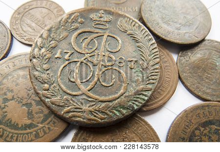 Pile Of Vintage Metall (copper) Coins.coins Of The Russian Empire In The Background Kopyur.antikvari