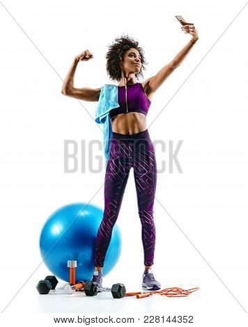 Sporty Girl Taking Selfie Pictures On Smartphone With Sports Accesories On White Background. Strengt