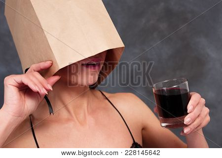 Unknown Lady Drinking Alcohol Cocktail. Incognito, Danger, Alcohol Party Concept