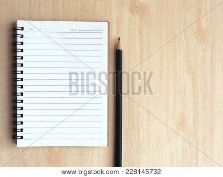 Soft Focus To-do List Paper With Check Box With Black Pencil On A Light Wooden Table, Business Plann
