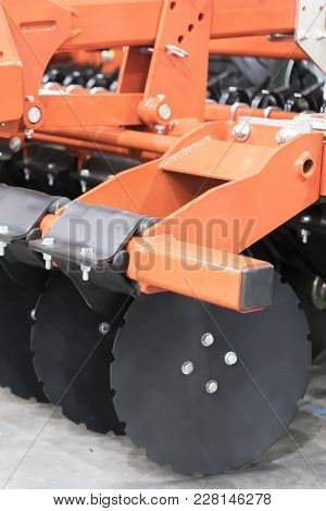 Working Parts Of New Modern Agricultural Disc Harrow. Tillage Equipment. Close-up View Of Cultivatin