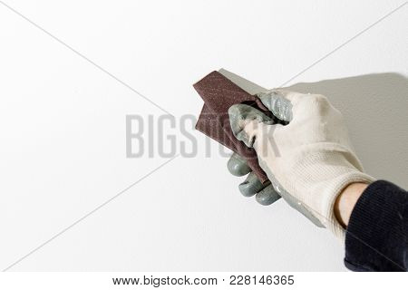 Sanding Wall With Sandpaper White Wall Compositio