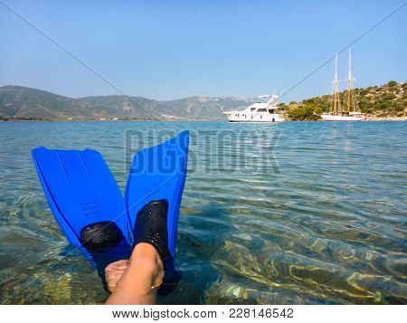 Summer Wellness Holidays By The Sea Concept, Feet In Fins On The Beach Of Love Bay Poros Island, Agr