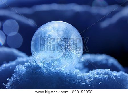 Magic Of Winter, Frozen Soap Bubble Ball On Snow, Crystal Formations, Dark Blue Background