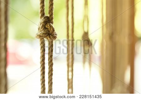 Knot On A Vertically Suspended Rope Against A Warm Summer Day, Selective Focus.