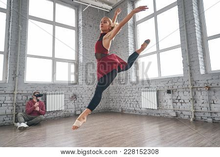 Young Female Dancer Jumping And Dancing In The Gym. Fashion Ballet Dancer. Studio Shot