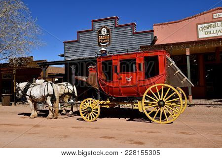 Tombstone, Arizona, February 6, 2018: The White Percheron Horses And Red Carriage Is In Tombstone Az