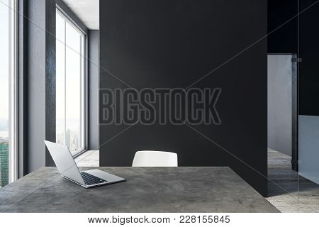 Modern Office Interior With City View, Laptop And Copy Space On Concrete Wall. Mock Up, 3d Rendering