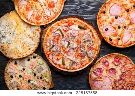 Six Different Pizza Set For Menu On Wooden Table. Italian Food. Pizzas With Salami And Ham, Quattro