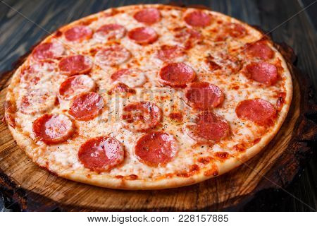 Delicious Fresh Baked Pizza With Pepperoni And Cheese, Close Up. Italian Traditional Cuisine, Fast F