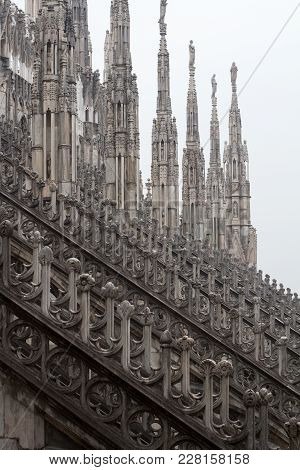 Vertical Perspective View Of Columns Statues And Towers On Gothic Architecture Milan Cathedral Dome