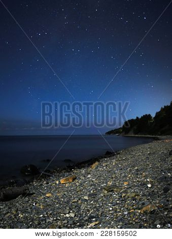 Stars Over The Sea. Long Time Exposure Night Landscape