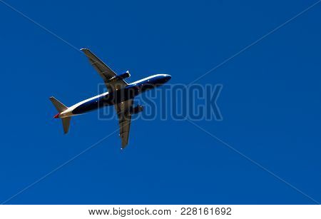 Passenger Plane Flying In The Blue Sky, Cruise Aircraft, Transport Industry