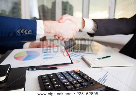 Business People Shaking Hands Finishing Up A Meeting Handshake. Marketing Strategy Brainstorming. Pa