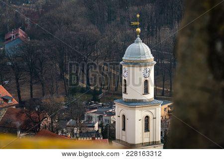 High Clock Tower Of The Saint Jadwiga Catholic Church In Bolkow Town In Lower Silesia, Poland, As Se