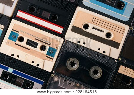Retro Cassette Tapes Collection Background, Close-up. Colorful Vintage Audio Cassette, View From Abo