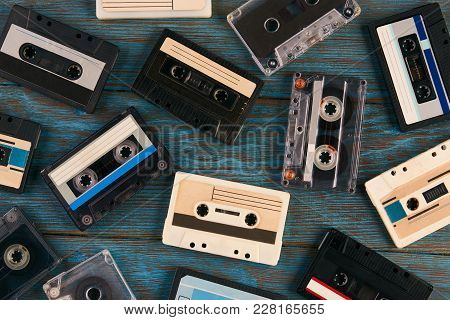 Cassette Tape Background, Top View. Collection Of A Retro Audio Cassette On Blue Wooden Background,
