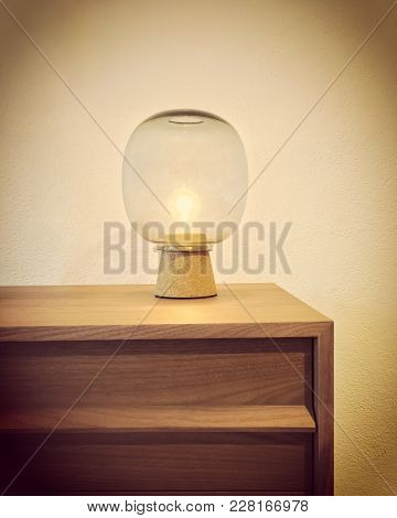 Retro Style Glass Lamp On A Wooden Dresser. Cozy Home Decor.