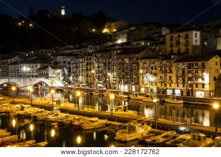 Ondarroa, Spain - September 30, 2015: Boats Docking In Marina At Night, Old Spanish Town Buildings I
