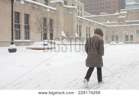 Determined Woman Braves The Weather Elements Outdoors As She Commutes To Work Downtown Chicago In A