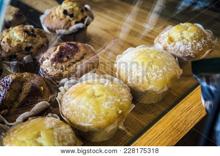 Fresh Various Muffins On Wooden Background. Top View.