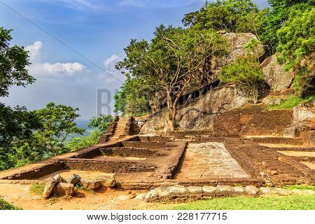 Ruins Of Ancient Buildings On The Top Of The Mountain Sigiriya Overlooking The Cloudy Sky, Sri Lanka