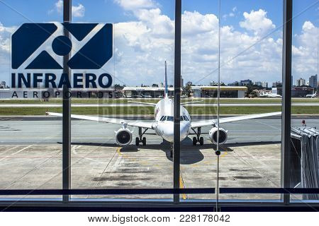 Sao Paulo, Brazil, February 25, 2013. Airplane Is Seen On The Runway From The Departure Lounge Of Co