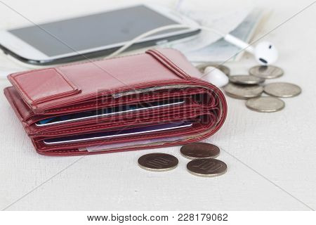 Money With Credit Card In Red Purse And Coins Mobile Phone Slips Of Expense On Table White