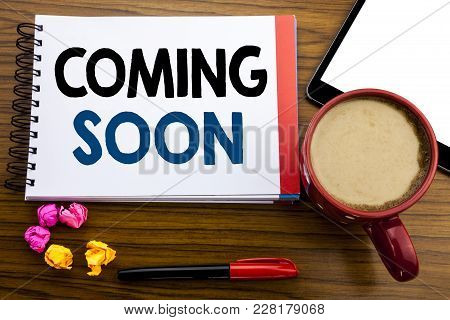 Handwritten Text Showing Coming Soon. Business Concept Writing Under Construction Written On Notepad