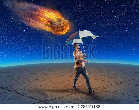 Man Holds An Umbrella While Walking And A Meteor Falling Down Right Behind Him. The Concept Of Carel