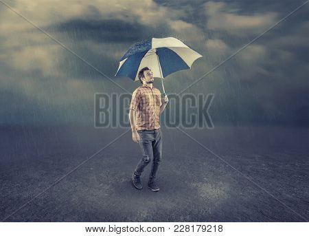 Man Hold An Umbrella While Walk On A Rainy Day.